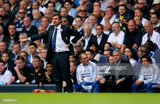 Andre VillasBoas manager of Tottenham Hotspur signals as Jose Mourinho manager of Chelsea looks on during the Barclays Premier League match between...