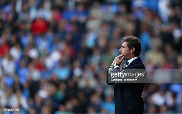 Andre VillasBoas manager of Tottenham Hotspur whistles during the Barclays Premier League match between Reading and Tottenham Hotspur at Madejski...