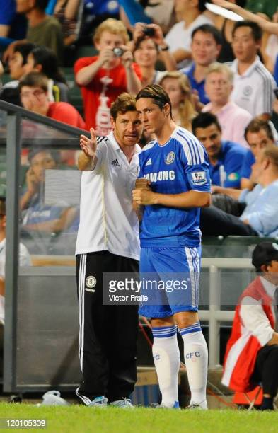 Andre VillasBoas of Chelsea gives instructions to Fernando Torres during the Asia Trophy Final match against Aston Villa at the Hong Kong Stadium on...