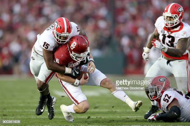 Andre Walker of the Georgia Bulldogs sacks Baker Mayfield of the Oklahoma Sooners in the third quarter during the 2018 College Football Playoff...
