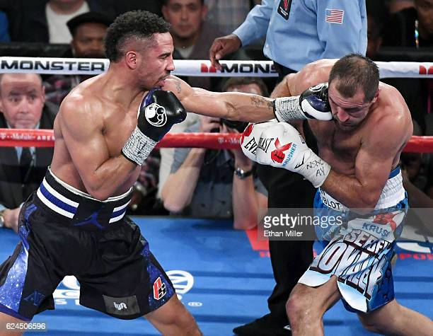 Andre Ward hits Sergey Kovalev with a left in the eighth round of their light heavyweight championship bout at TMobile Arena on November 19 2016 in...