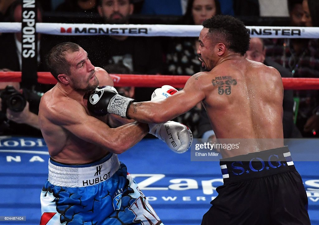 Andre Ward (R) hits Sergey Kovalev with a left in the seventh round of their light heavyweight championship bout at T-Mobile Arena on November 19, 2016 in Las Vegas, Nevada. Ward took Kovalev's WBA, IBF and WBO titles with a unanimous-decision victory.