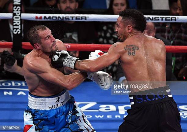 Andre Ward hits Sergey Kovalev with a left in the seventh round of their light heavyweight championship bout at TMobile Arena on November 19 2016 in...