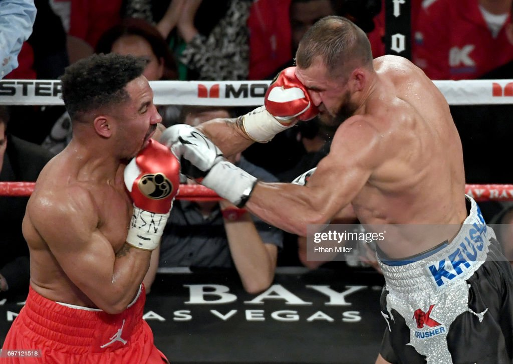 Andre Ward (L) hits Sergey Kovalev with a left in the sixth round of their light heavyweight championship bout at the Mandalay Bay Events Center on June 17, 2017 in Las Vegas, Nevada. Ward retained his WBA/IBF/WBO titles with a TKO in the eighth round.