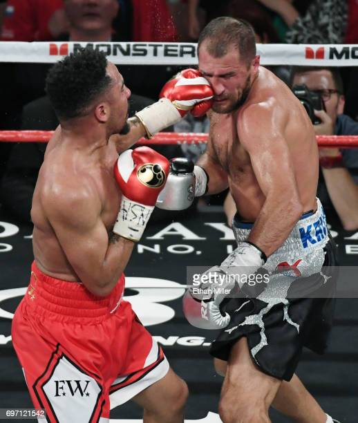 Andre Ward hits Sergey Kovalev with a left in the sixth round of their light heavyweight championship bout at the Mandalay Bay Events Center on June...