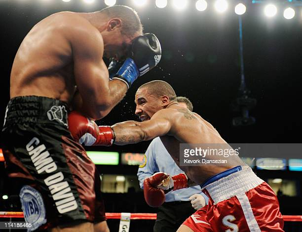 Andre Ward lands a punch to the stomach of Arthur Abraham of Germany during the fourth round of the WBA super middleweight bout and Super Six...