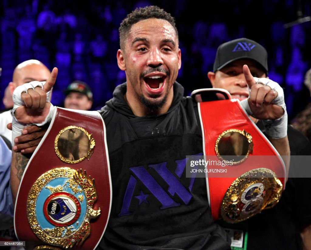 TOPSHOT - Andre Ward of the US celebrates his unanimous decision victory over Sergey Kovalev of Russia to win their WBA, IBF and WBO lightheavyweight world championship fight on November 19, 2016 at the T-Mobile Arena in Las Vegas, Nevada. Ward, the 2004 Olympic champion, recovered from a second round knockdown to defeat Kovalev by the same score of 114-113 on all three judges cards after an attritional battle at Las Vegas's T-Mobile Arena. / AFP / John GURZINSKI