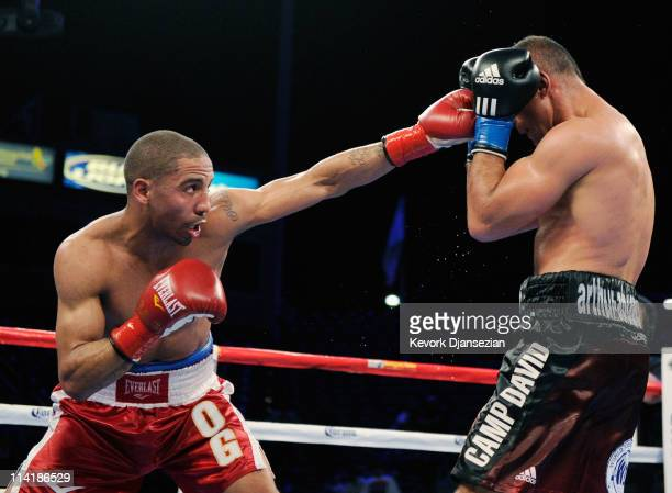 Andre Ward punches Arthur Abraham of Germany during the 10th round of the WBA super middleweight bout and Super Six semifinals at the Home Depot...