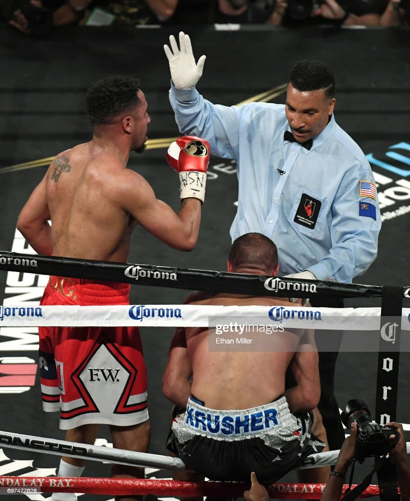Andre Ward (L) reacts as reacts as referee Tony Weeks stops his light heavyweight championship bout against Sergey Kovalev at the Mandalay Bay Events Center on June 17, 2017 in Las Vegas, Nevada. Ward retained his WBA/IBF/WBO titles with a TKO in the eighth round.