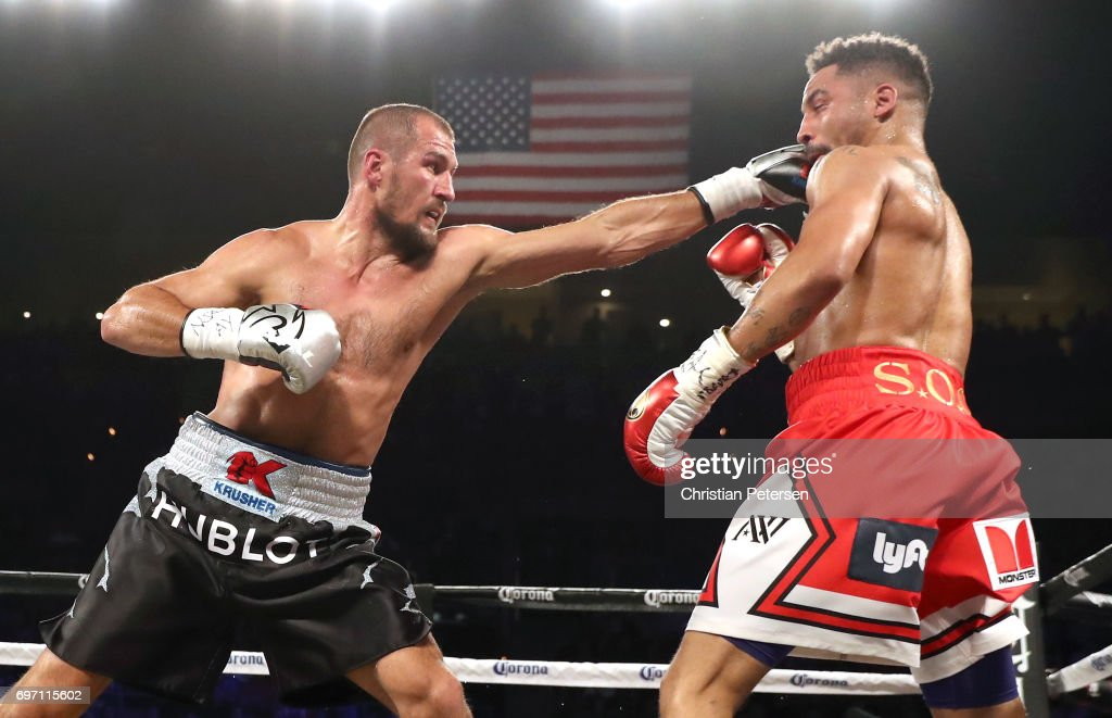 Andre Ward (R) takes a punch from Sergey Kovalev during their light heavyweight championship bout at the Mandalay Bay Events Center on June 17, 2017 in Las Vegas, Nevada.