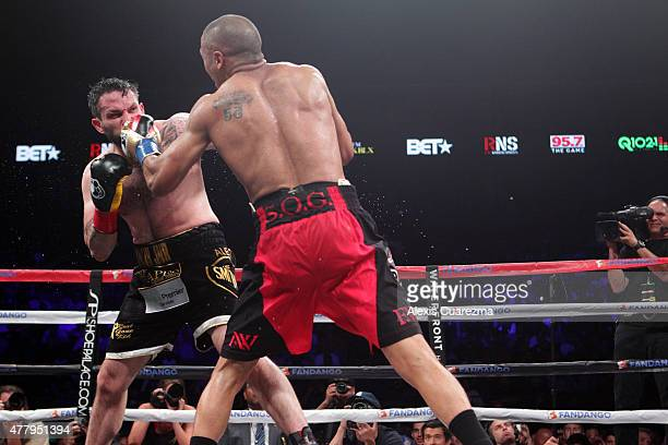 Andre Ward throws a left hook against Paul Smith during their Cruiserweight fight at ORACLE Arena on June 20 2015 in Oakland California