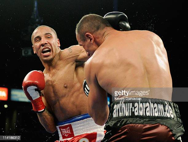 Andre Ward throws a punch against Germany's Arthur Abraham during the 11th round to defend his WBA super middleweight title and advance to the Super...