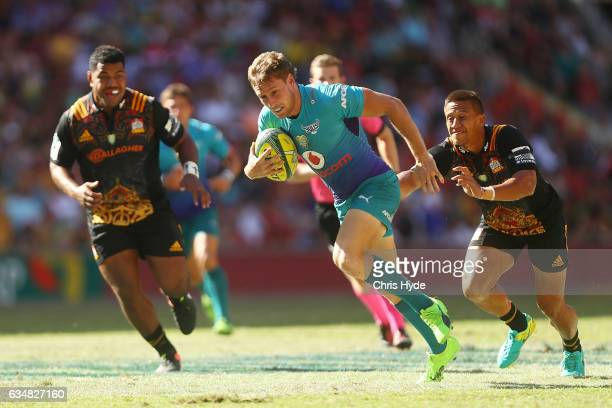 Andre Warner of the Bulls makes a break to score a try during the Rugby Global Tens Semi Final match between Bulls and Chiefs at Suncorp Stadium on...