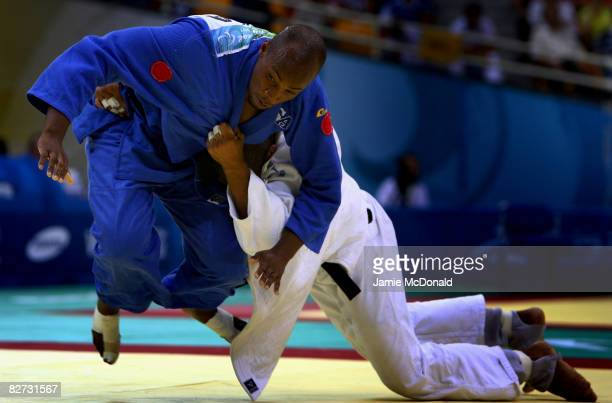 Andre Watson of the USA competes in the Judo -90kg match against Messaoud Nine of Algeria at the Beijing Workers' Gymnasium during day 3 of the...