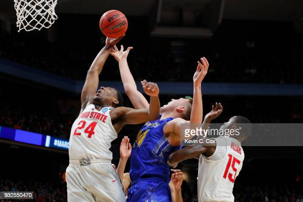 Andre Wesson of the Ohio State Buckeyes battles for a rebound with Mike Daum of the South Dakota State Jackrabbits in the second half during the...