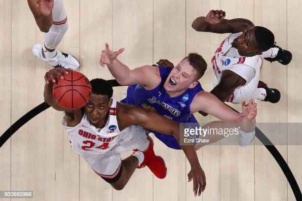Andre Wesson of the Ohio State Buckeyes battles for the ball with Mike Daum of the South Dakota State Jackrabbits during the first round of the 2018...