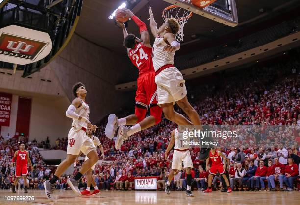 Andre Wesson of the Ohio State Buckeyes goes up for the winning dunk against Romeo Langford of the Indiana Hoosiers at Assembly Hall on February 10...