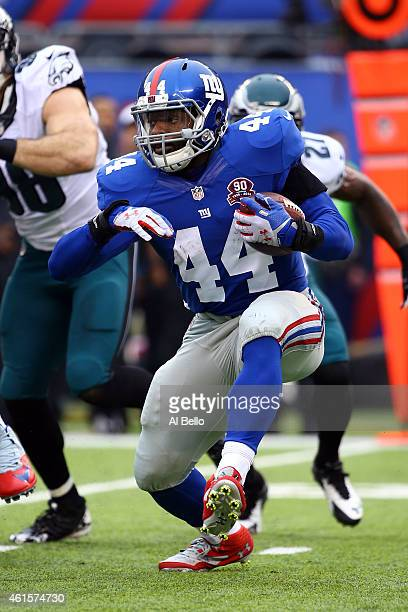 Andre Williams of the New York Giants carries the ball against the Philadelphia Eagles during a game at MetLife Stadium on December 28 2014 in East...