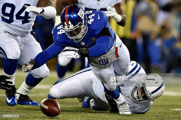 Andre Williams of the New York Giants fumbles the ball in the first quarter against the Indianapolis Colts during their game at MetLife Stadium on...