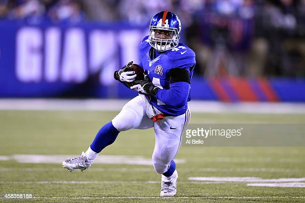 Andre Williams of the New York Giants runs the ball against the Indianapolis Colts during their game at MetLife Stadium on November 3 2014 in East...