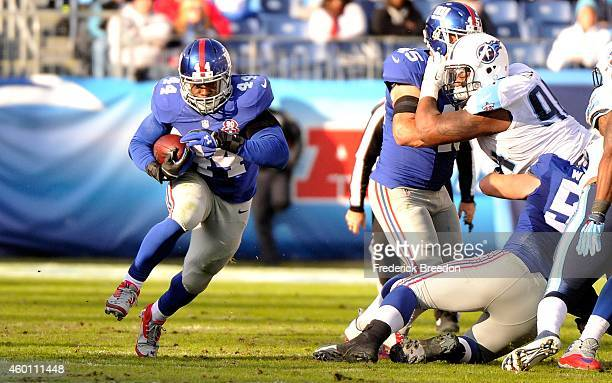 Andre Williams of the New York Giants rushes against the Tennessee Titans during the second half of a game at LP Field on December 7 2014 in...