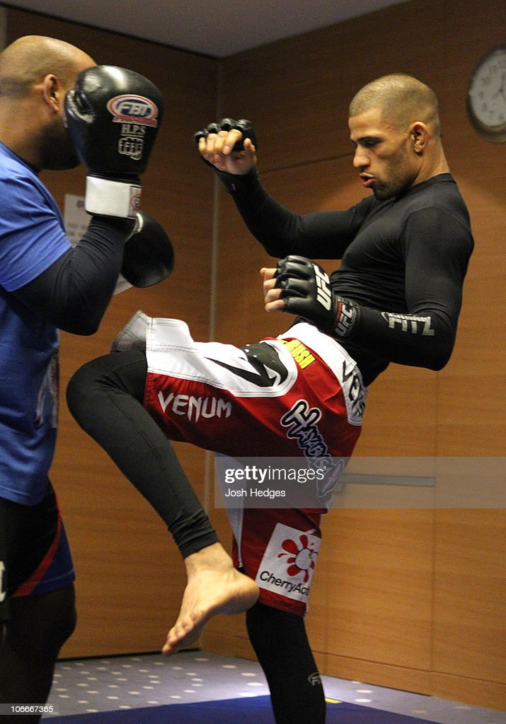 Andre Winner (R) works out with trainer Dean Amasinger at the UFC 122 open workouts at the Hilton Hotel on November 10, 2010 in Dusseldorf, Germany.