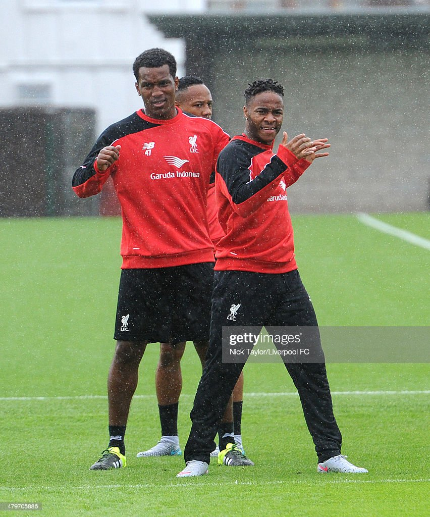 Andre Wisdom and Raheem Sterling warm up as Liverpool players return for pre-season training at Melwood Training Ground on July 6, 2015 in Liverpool, England.