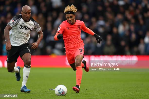 Andre Wisdom of Derby County and Juninho Bacuna of Huddersfield Town during the Sky Bet Championship match between Derby County and Huddersfield Town...