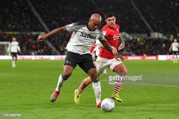 Andre Wisdom of Derby County battles with Alex Mowatt of Barnsley during the Sky Bet Championship match between Derby County and Barnsley at the...