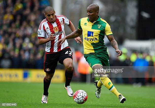Andre Wisdom of Norwich City is closed down by Wahbi Khazri of Sunderland during the Barclays Premier League match between Norwich City and...