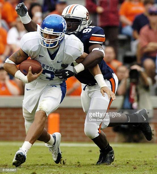 Andre Woodson of the Kentucky Wildcats is sacked by Neil Brown of the Auburn Tigers on October 23 2004 at JordanHare stadium in Auburn Alabama Auburn...