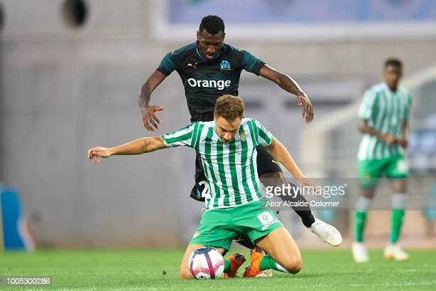 Andre Zambo Anguissa of Olympique Marseille competes for the ball with Loren Moron of Real Betis Balompie during the preseason friendly match between...