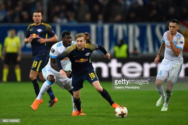 Andre Zambo Anguissa of Olympique Marseille tackles Emil Forsberg of RB Leipzig during the UEFA Europa League quarter final leg two match between...