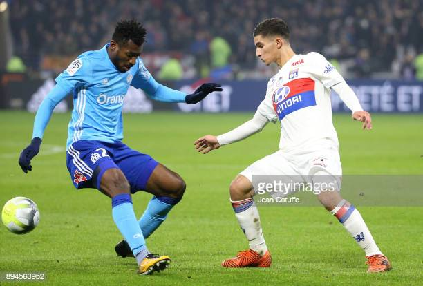 Andre Zambo Anguissa of OM Houssem Aouar of Lyon during the French Ligue 1 match between Olympique Lyonnais and Olympique de Marseille at Groupama...
