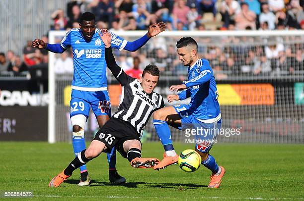 Andre Zambo Anguissa Pierrick Capelle and Remy Cabella during the French Ligue 1 match between Angers SCO and Olympique de Marseille on May 1 2016 in...