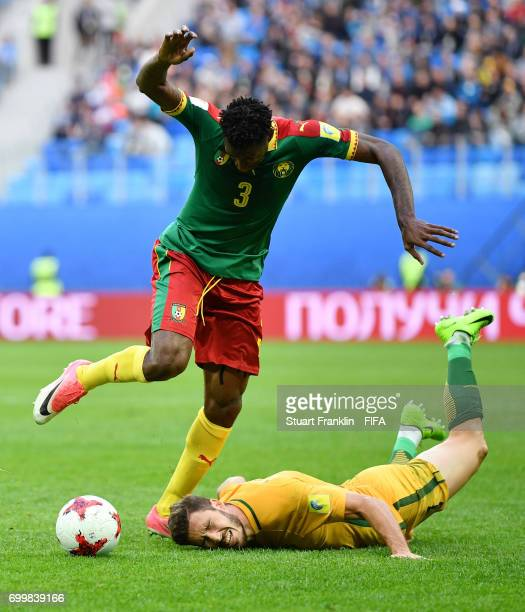 Andre Zambo of Cameroon and Mathew Leckie of Australia battle for possession during the FIFA Confederations Cup Russia 2017 Group B match between...