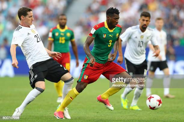 Andre Zambo of Cameroon is closed down by Sebastian Rudy of Germany during the FIFA Confederations Cup Russia 2017 Group B match between Germany and...