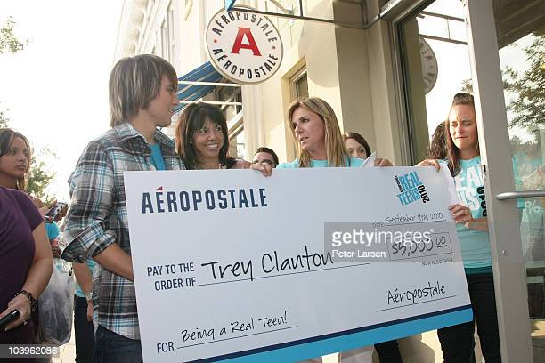 (Andrea Adams and Holly Mullins RVM of Aeropostale present a check to Trey Clanton at the Aeropostale Real Teens 2010 Hometown Event on September 9,...