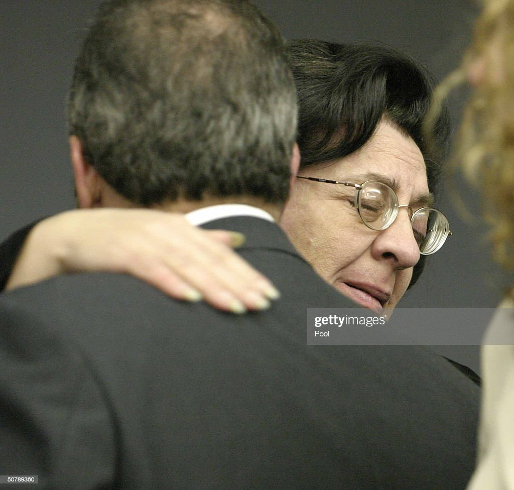 Andrea Adams (R), sister of slain limo driver Costas 'Gus' Christofi, hugs Hunterdon County First Assistant Prosecutor Steven Lember, after the verdict was read in the Jayson Williams' manslaughter trial at the Somerset County Courthouse April 30, 2004 in Somerville, New Jersey. Williams was acquitted of the most serious charge of aggravated manslaughter in the shooting death of Costas 'Gus' Christofi. He was found guilty on four counts, hindering apprehension or prosecution, tampering with evidence, tampering with a witness and fabricating evidence and the jury could not reach a verdict on a reckless manslaughter charge.