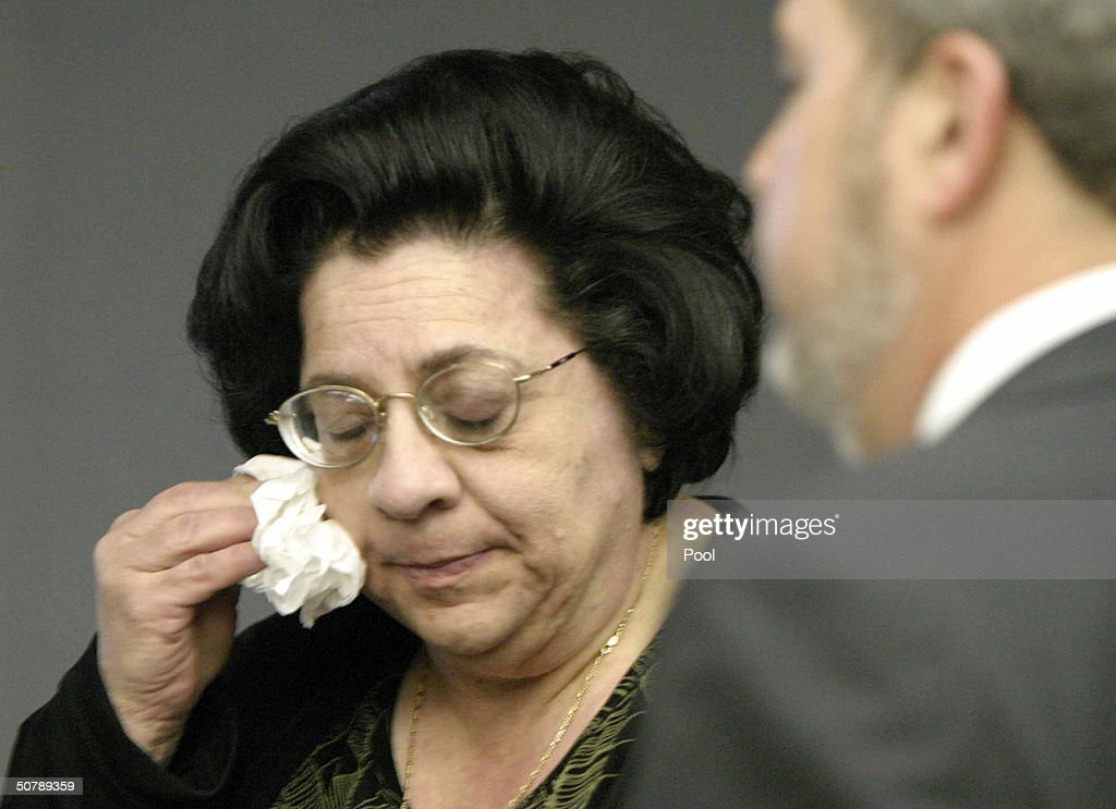 Andrea Adams, sister of slain limo driver Costas 'Gus' Christofi, wipes her face after the verdict was read in the Jayson Williams' manslaughter trial at the Somerset County Courthouse April 30, 2004 in Somerville, New Jersey. Williams was acquitted of the most serious charge of aggravated manslaughter in the shooting death of Costas 'Gus' Christofi. He was found guilty on four counts, hindering apprehension or prosecution, tampering with evidence, tampering with a witness and fabricating evidence and the jury could not reach a verdict on a reckless manslaughter charge.