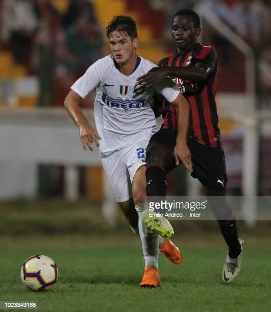 Andrea Adorante of FC Internazionale is challenged by Siaka Haidara of AC Milan during the Trofeo Mamma Cairo match between FC Internazionale U19 and...