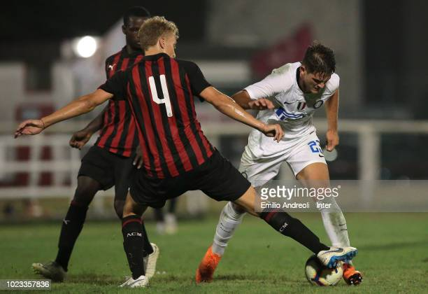 Andrea Adorante of FC Internazionale is challenged by Tommaso Merletti of AC Milan during the Trofeo Mamma Cairo match between FC Internazionale U19...