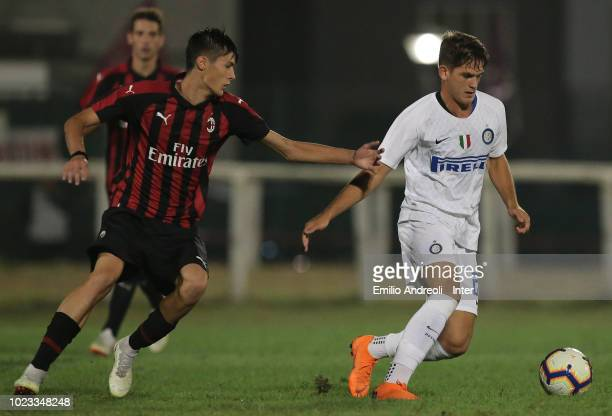 Andrea Adorante of FC Internazionale is challenged during the Trofeo Mamma Cairo match between FC Internazionale U19 and AC Milan U19 on August 25...
