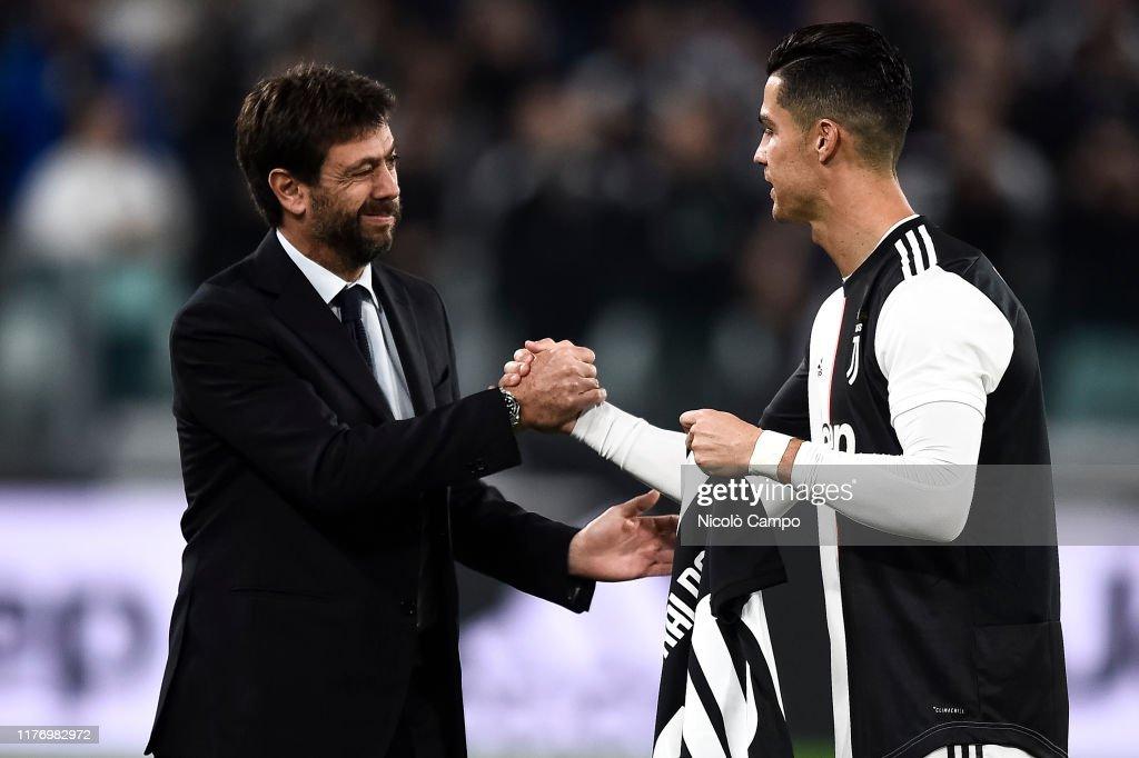 Andrea Agnelli Shakes Hands With Cristiano Ronaldo Of