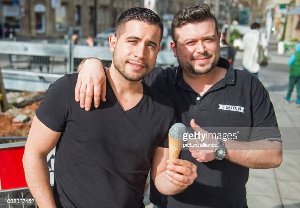Andrea  and Sandro Scopelliti brothers and owners of an ice cream parlour pose with an ice cream cone next to a construction site which inspired them...
