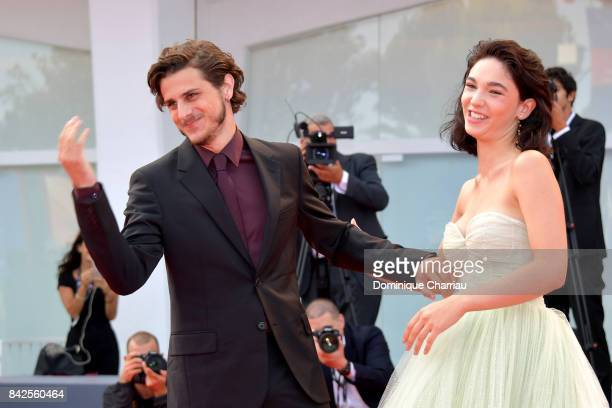 Andrea Arcangeli and Matilda De Angelis walk the red carpet ahead of the 'Una Famiglia' screening during the 74th Venice Film Festival at Sala Grande...
