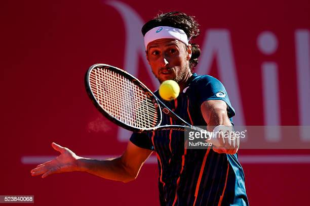 Andrea Arnaboldi from Italy returns a ball to Salvatore Caruso from Italy during their Millennium Estoril Open ATP Singles qualifying 2nd round...