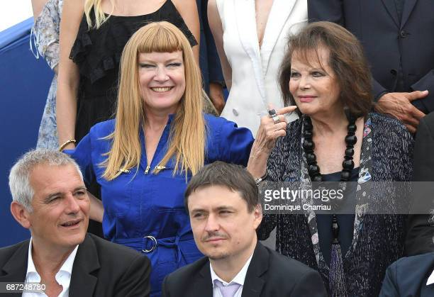 Andrea Arnold Claudia Cardinale and Laurent Cantet Cristian Mungiu attend the 70th Anniversary photocall during the 70th annual Cannes Film Festival...