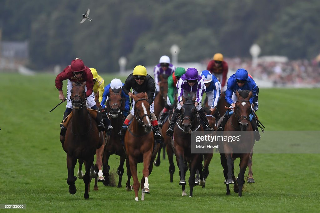 Andrea Atzeni on Stradivarius (centre, yellow cap) wins the Queen's Vase on Day Four of Royal Ascot at Ascot Racecourse on June 23, 2017 in Ascot, England.