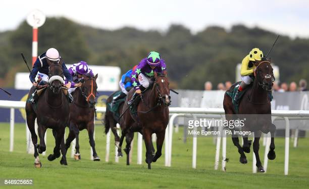 Andrea Atzeni onboard Laugh a Minute wins the Weatherbys Racing Bank 300000 2YO Stakes during day two of the William Hill St Leger Festival at...